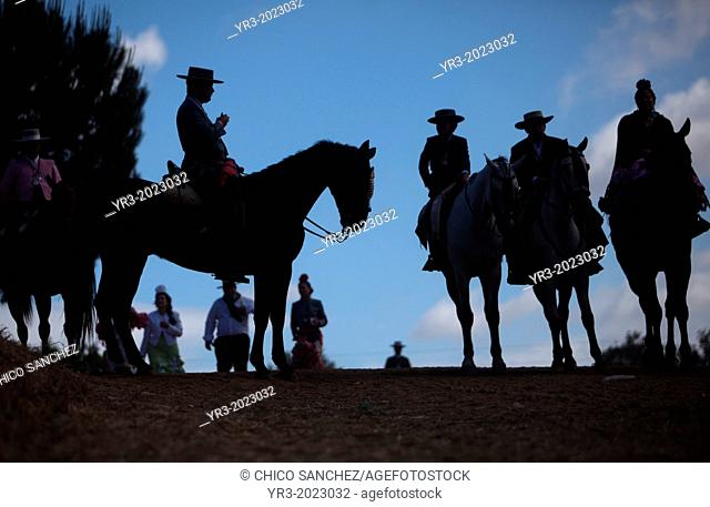 Riders wait to cross in the Guadiamar's river ford, known as Vado del Quema, during the pilgrimage to the shrine of the Virgin of Rocio, in Aznalcazar