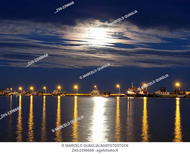 Full moon over Sant Carles de la Rapita fishing harbor. Ebro Delta Natural Park. Tarragona Province, Catalonia, Spain