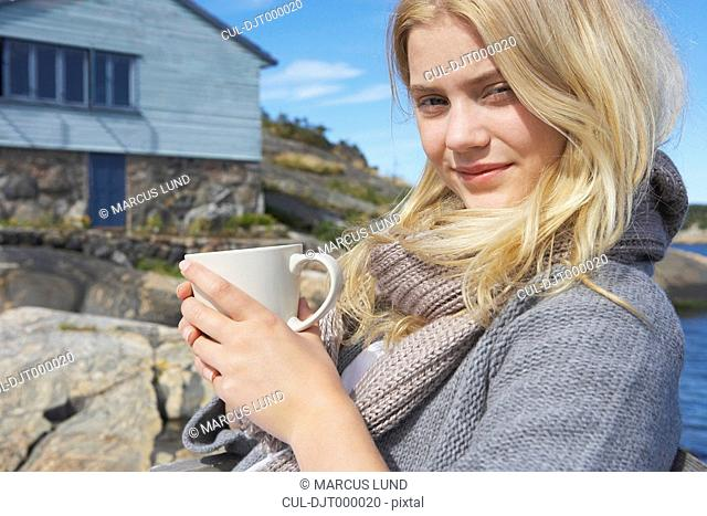 Young Woman drinking Coffee or Tea