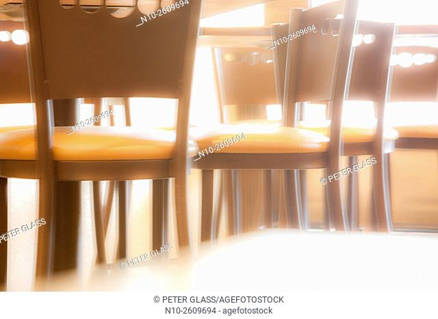 Empty chairs and tables in a restaurant