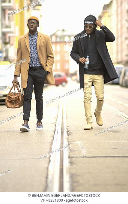 streetstyle, two stylish men walking on street in city, in Munich, Germany
