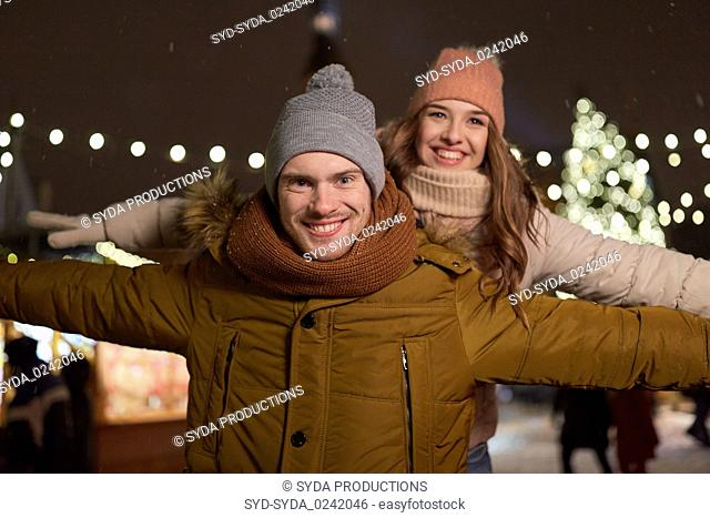 happy couple having fun at christmas market