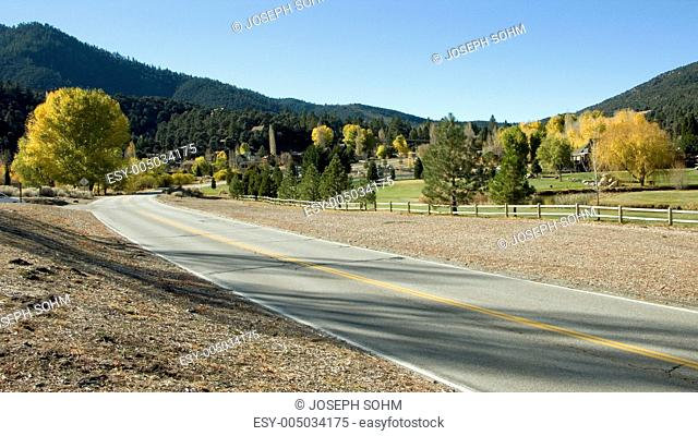 Road into Pine Mountain Club with view of 9-hole golf course in autumn, Pine Mountain Club, California