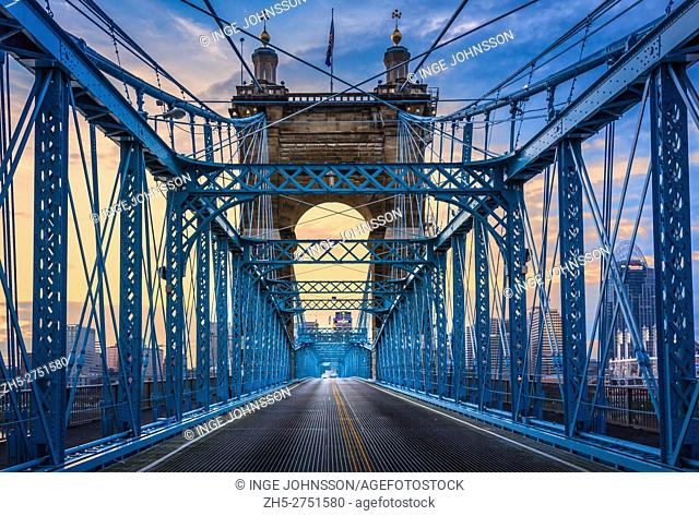 The John A. Roebling Suspension Bridge spans the Ohio River between Cincinnati, Ohio and Covington, Kentucky. When the first pedestrians crossed on December 1