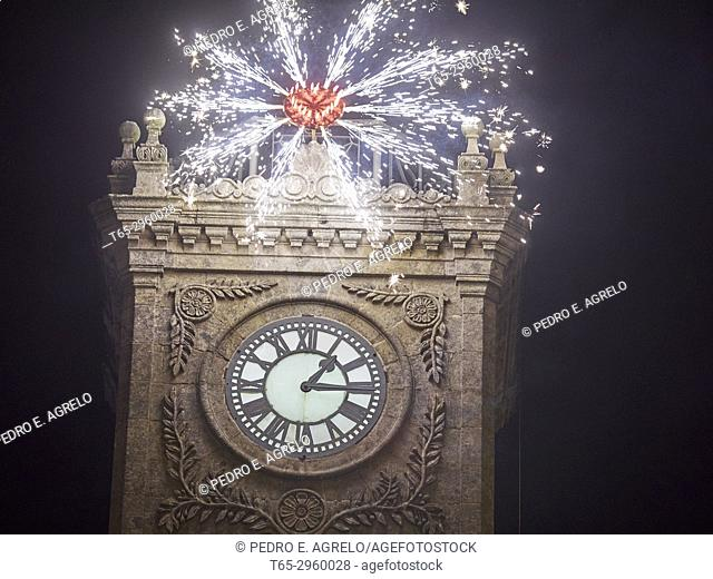 View of the clock of the town hall of Lugo. The fires of art give beginning to the celebrations of San Froilan, patron of the city of Lugo