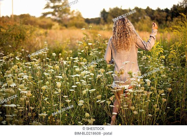 Woman walking in rural field