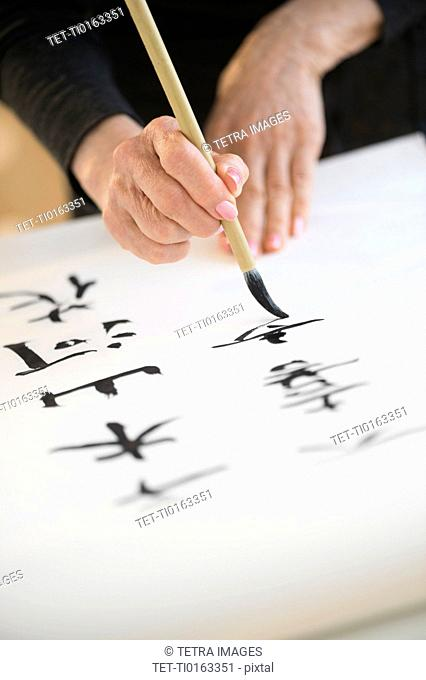 Female hands and japanese calligraphy