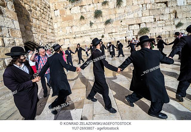 Orthodox Jews dancing in front of Western Wall (also called Kotel or Wailing Wall), Jewish Quarter, Old Town, Jerusalem, Israel