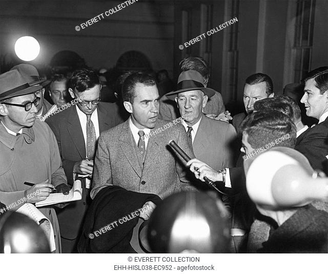 Vice President Richard Nixon with reporters on Nov. 26, 1957. They questioned the VP on Eisenhower's mild stroke of the previous day which left the President...
