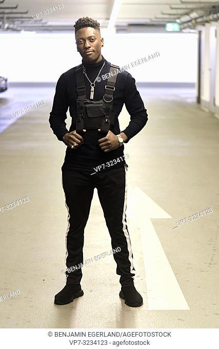 fashionable man in parking garage, male blogger