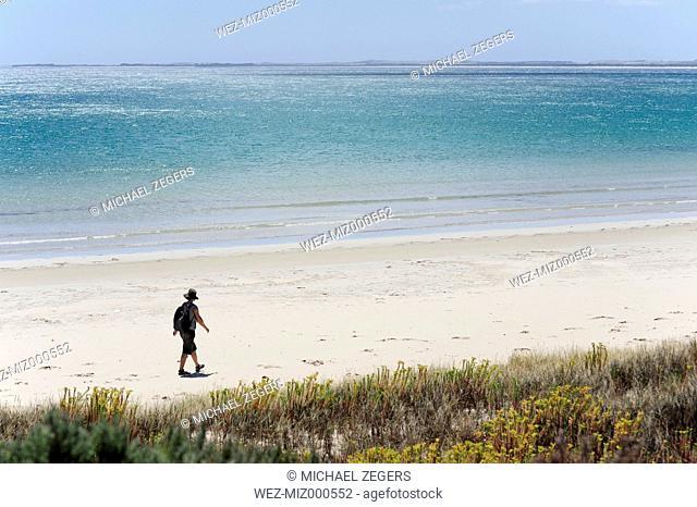 Australia, South Australia, Robe, woman walking on the beach
