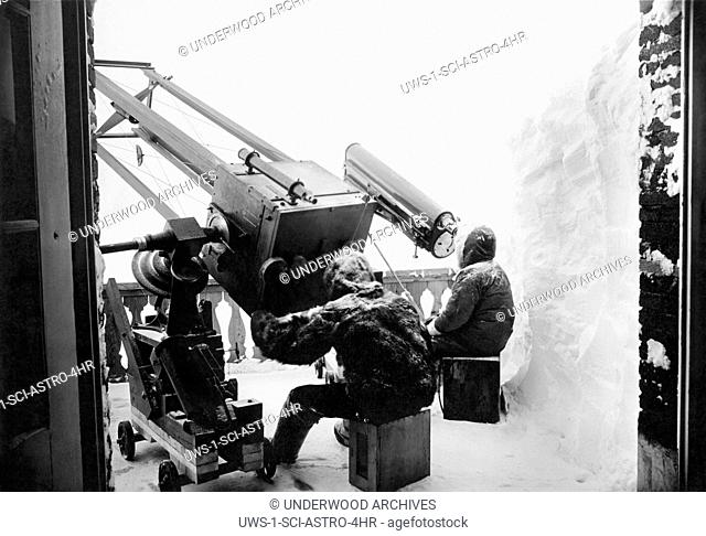 Jungfraujoch, Switzerland: c. 1927 Astronomers at work at the outdoor observatory at 11,500 above sea level in the Bernese Oberland in the Swiss Alps