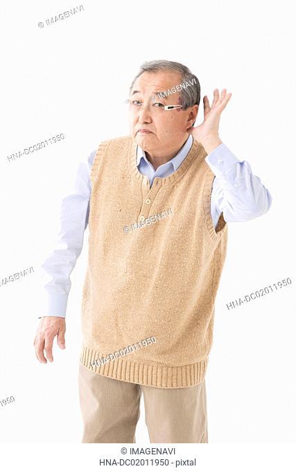 Senior man having trouble hearing