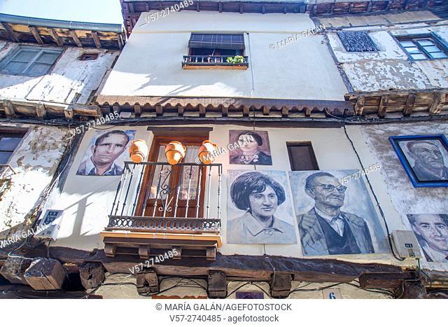 Facade of house and portrait of its owners. Mogarraz, Sierra de Francia Nature Reserve, Salamanca province, Castilla Leon, Spain