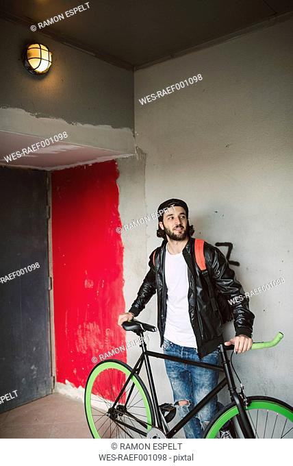 Young man with fixie bike