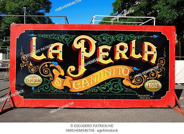 Argentina, Buenos Aires, La Boca district, La Perla de Caminito sign showing a tango singer on Mendoza Avenue near Caminito street