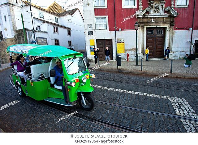 Tuk Tuk, Largo das Portas do Sol Street, on background Azurara Palace, Decorative Arts Museum, Alfama District, Lisbon, Portugal, Europe