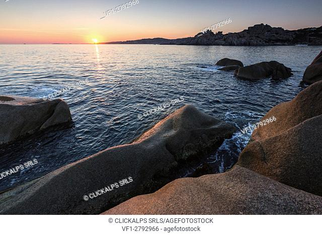 Sunset on modeled cliffs by wind framing blue sea Capo Testa Santa Teresa di Gallura Province of Sassari Sardinia Italy Europe