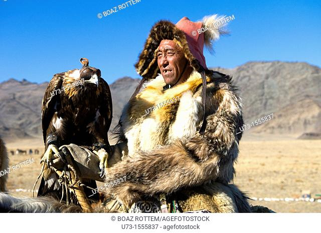 A Kazakh eagle hunter with his eagle