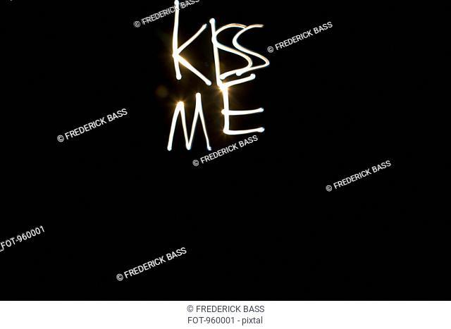 KISS ME written with light