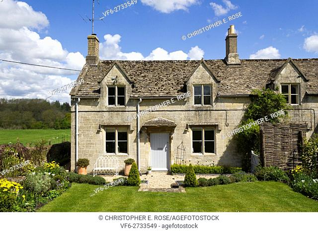 An idyllic rural Cotswold country cottage next to open countryside fields
