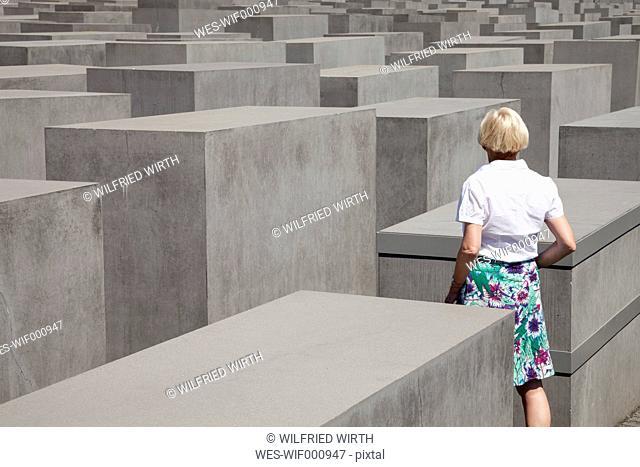 Germany, Berlin, Holocaust Memorial, Mature woman between steles