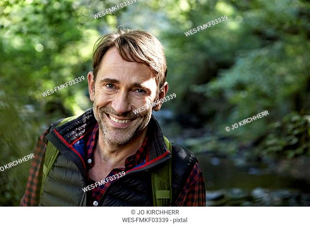 Hiker in forest, portrait