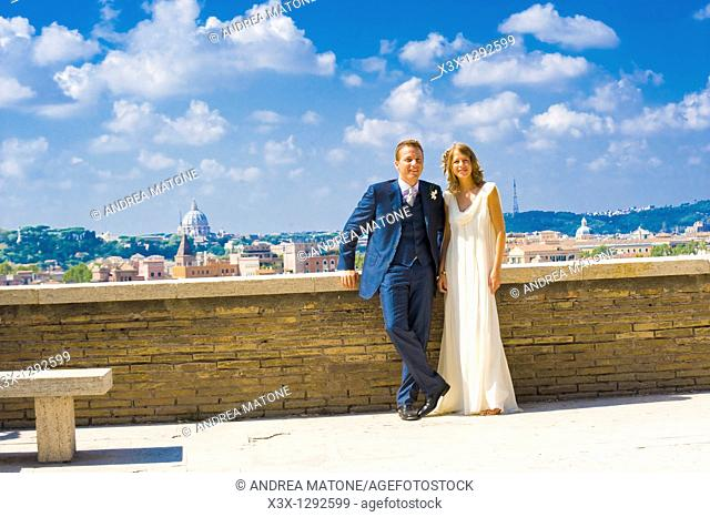 Portrait of bride and groom standing on rooftop in Rome, Italy