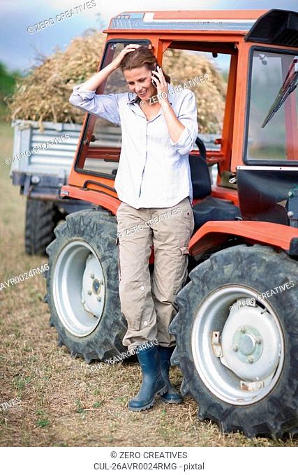 Female farmer at her mobile