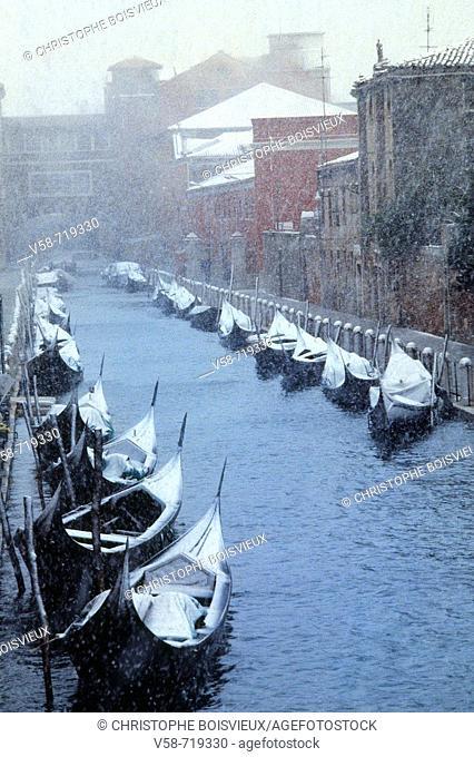 Snowstorm and gondolas. Venice. Italy