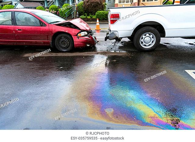Rainbow-colored oil spill caused by traffic accident in the rain