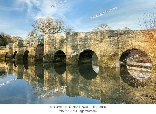 Autumn afternoon at medieval bridge in Stopham, West Sussex, England