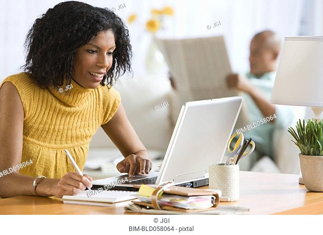 African woman looking at laptop