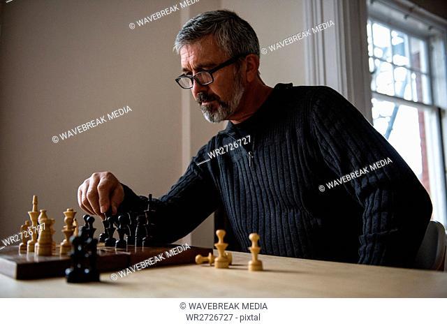 Attentive man playing chess