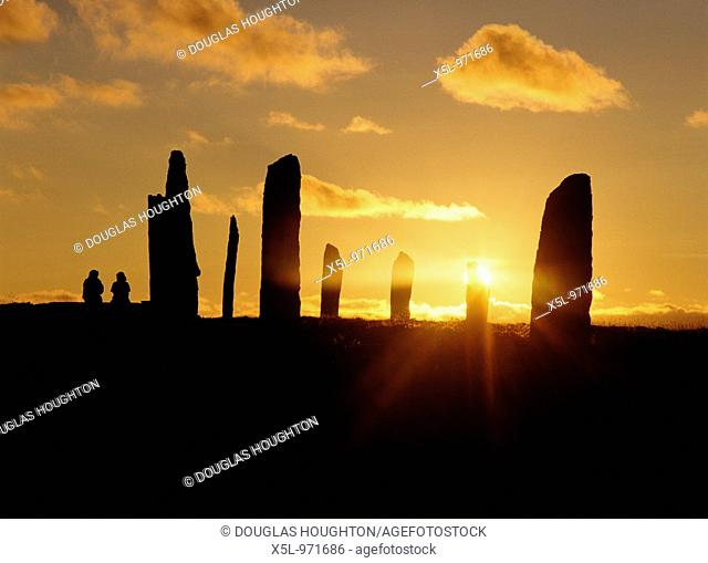 RING OF BRODGAR ORKNEY Standing stone circle and people sitting watching the sunset