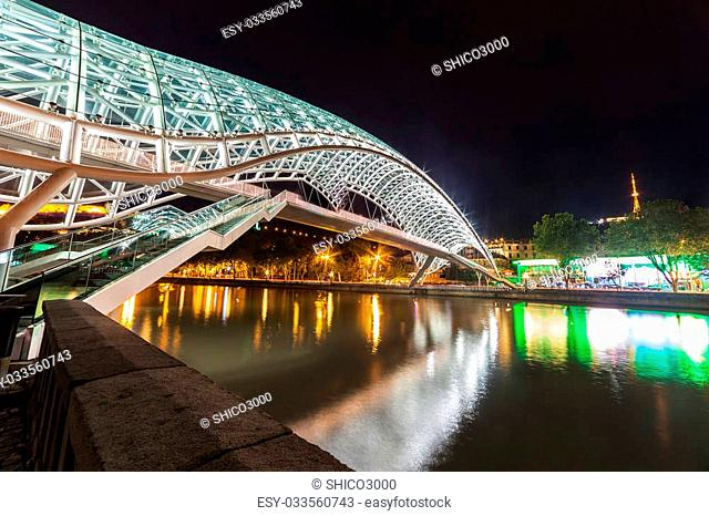 Tbilisi,Georgia- SEPTEMBER 8,2015: The peace bridge in Tbilisi, pedestrian bridge over the Mtkvari River in Tbilisi. On SEPTEMBER 8,2015. Tbilisi