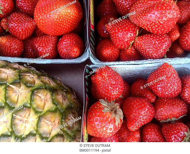 Fresh Strawberries and Pineapple on display at a Greengrocers, Crete, Greece