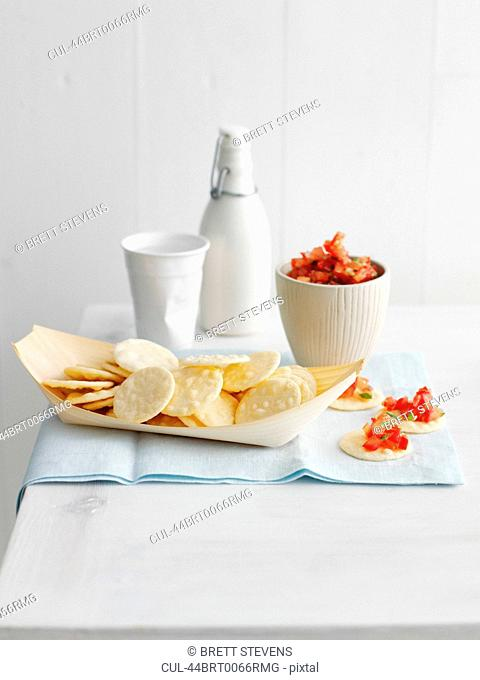 Plate of crackers with salsa