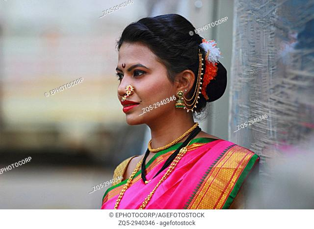 Young Indian girl in Nauwari sari , traditional Maharashtrian sari