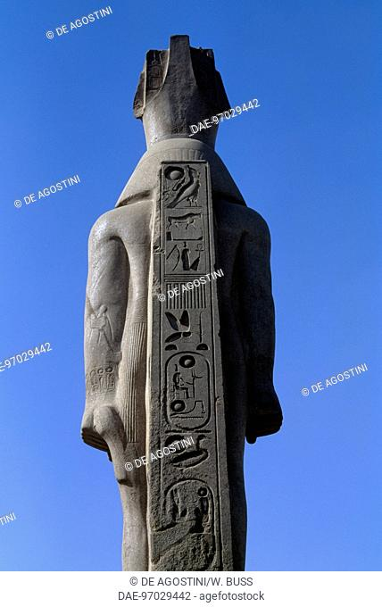 Rear view of the Colossus of Ramesses II, replica of the statue in Memphis in a Cairo street
