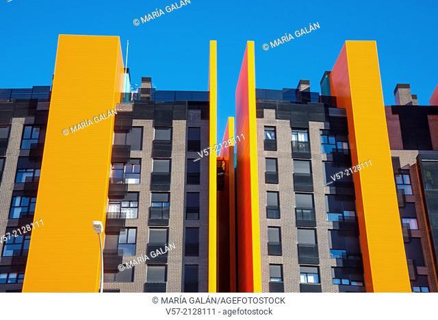 Facade of orange building. Ensanche de Vallecas Avenue, Madrid, Spain