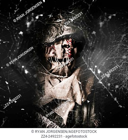 Creeping in the dark shadows a cruel evil entity watches from hanging spider webs. The monster scarecrow