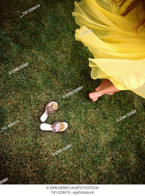 A woman spinning in a vintage yellow dress with her mother's vintage shoes left behind