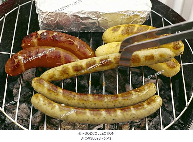 Sausages, Käsekrainer (with cheese) & chicken sausages on grill