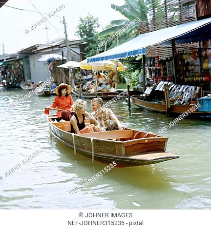 Young couple in a boat, Thailand