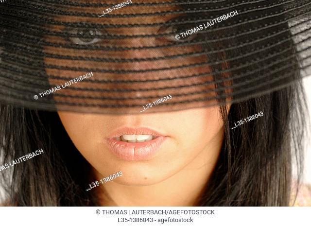 Woman looking through transparent brim