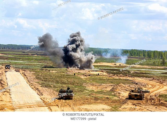 "Explosion, smoke and military vehicles. International Military Training """"Saber Strike 2017"""", Adazi, Latvia, from 3 to 15 June 2017"