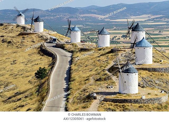 Windmills in a row along a road; Consuegra, Spain
