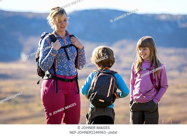 Mother hiking with children