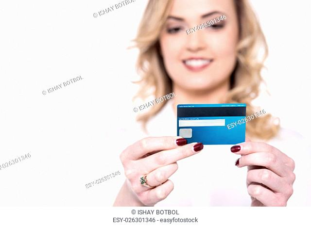 Smiling woman reading her credit card